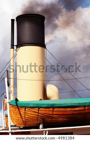 Black smoke from chimney of a boat - stock photo