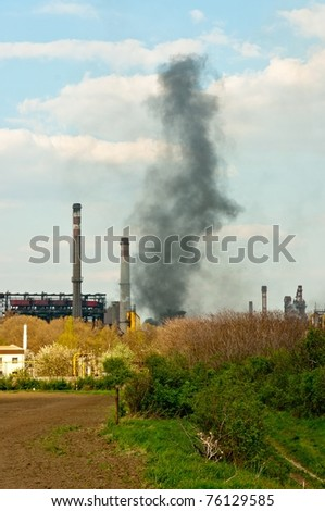 black smoke rises from power plant
