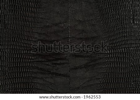 Black snakeskin leather texture background - stock photo