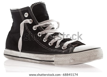 black sneakers isolated on a white background - stock photo