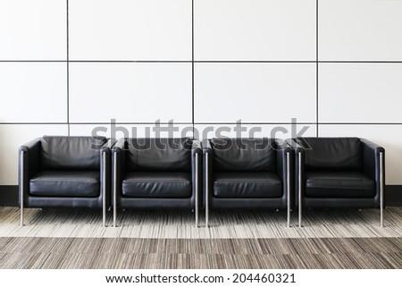 Black sofa in lobby. - stock photo