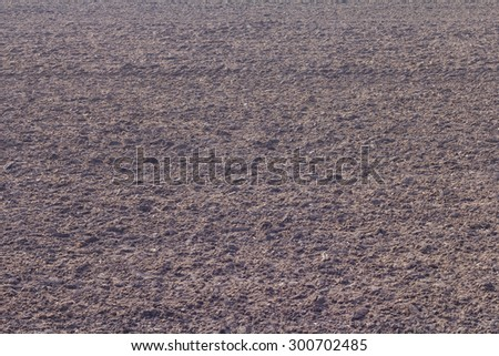Black soil is rich in organic matter, which tillage to prepare the cultivation of agriculture Thailand. - stock photo