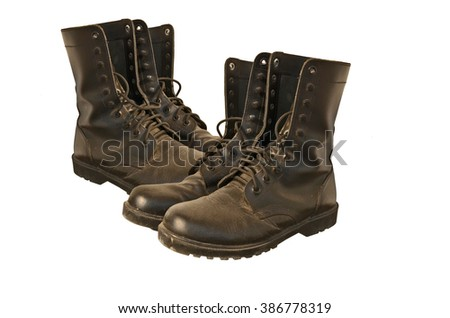 Black soldier boots on white background