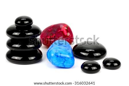 Black spa stones isolated on white - stock photo