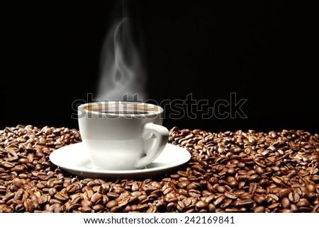 black space and coffee in white cup