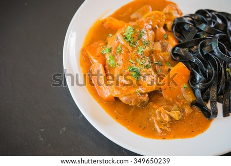 Black spaghetti with chicken stew. - stock photo