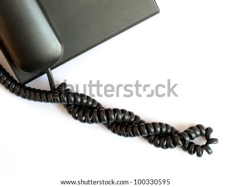Black spiral telephone cable on white background