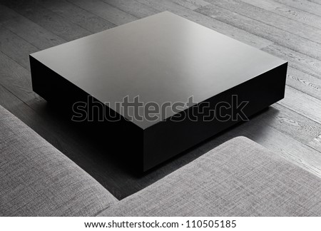 Black square coffee-table, modern interior detail - stock photo