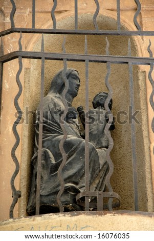 Black statue of Virgin Mary with baby Jesus - stock photo
