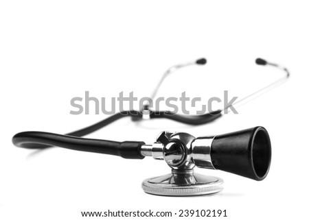 Black stethoscope  closeup isolated on white background - stock photo