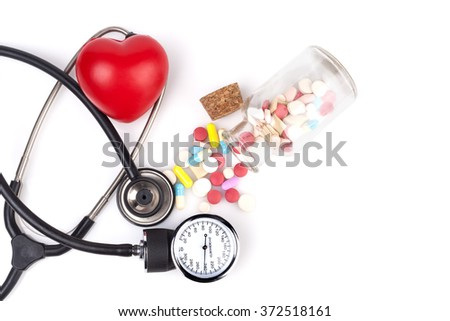 Black Stethoscope with jar of pills and red heart Close-up Isolated On White Background - stock photo