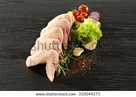 black stone and wings of chicken  - stock photo