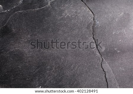 Black stone background. Abstract textured stone grunge surface. - stock photo