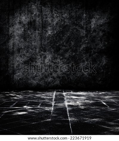Black stone chamber or room. Dark stone space with mysteriously illuminated tiled stone floor. - stock photo