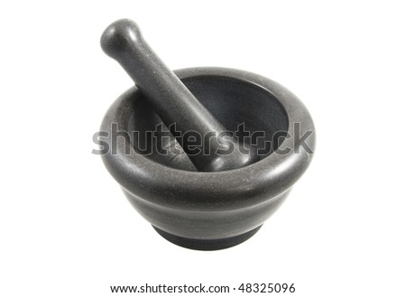 Black stone mortar and pestle over white background - stock photo