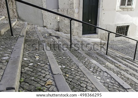Black stone staircase, detail of a staircase, pedestrians