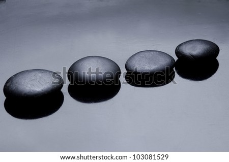 Black stones arranged - stock photo