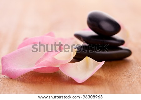 black stones tower with leaves - stock photo