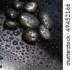 black stones with water drops - stock photo
