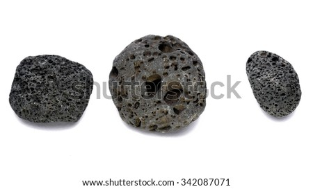 Black strange rock isolated on white closeup - stock photo