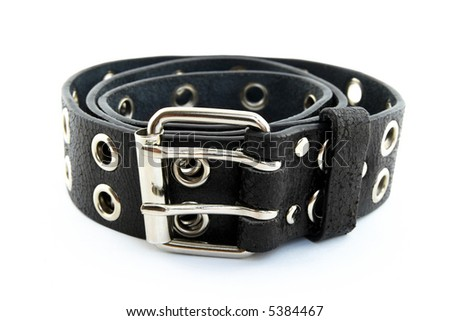 Black studded leather belt with metal buckle, on white background, shallow DOF. - stock photo