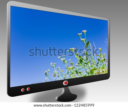 Black stylish glossy widescreen TFT display with blue sky - stock photo