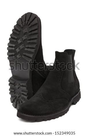 black suede boots on a white background - stock photo