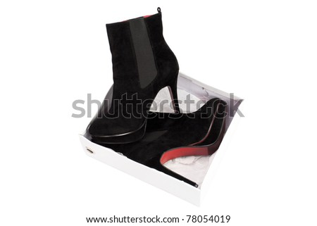 black suede boots with red soles on the platform and high heels - stock photo
