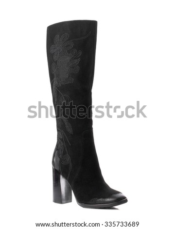 Black suede high boot on white background. - stock photo