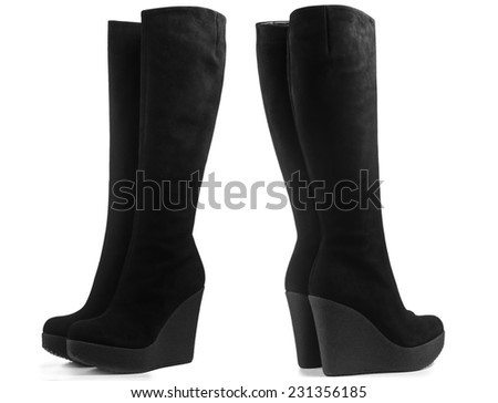 Black suede winter boots isolated on white background - stock photo