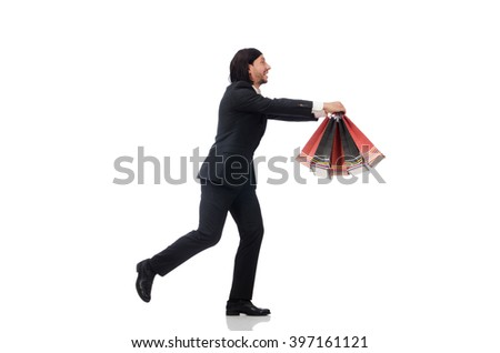 Black suit man holding plastic bags isolated on white