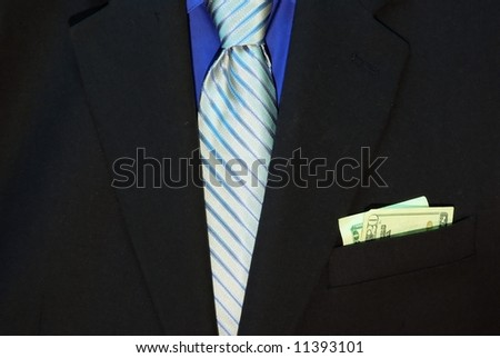 Black suit with blue shirt and tie and money in the pocket.