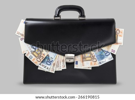 black suitcase full of banknotes - stock photo