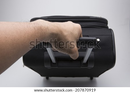 Black suitcase on a white background. - stock photo