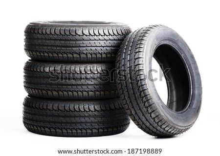 black summer tires isolated on white background - stock photo