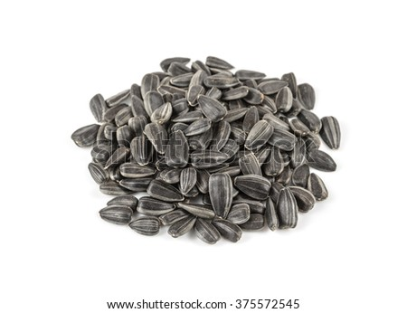 black sunflower seeds in a pile - stock photo