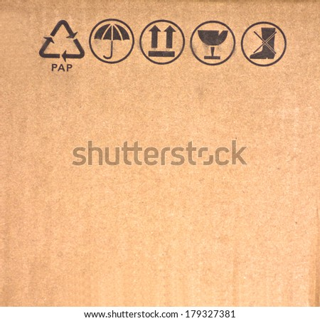 Black symbol on brown paper. - stock photo