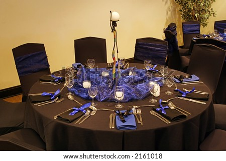 Black table setting in a african theme - stock photo