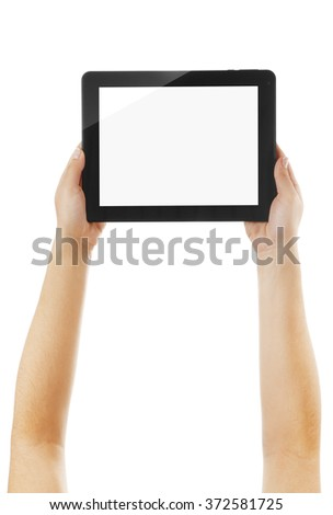 Black tablet in hands isolated on white background - stock photo