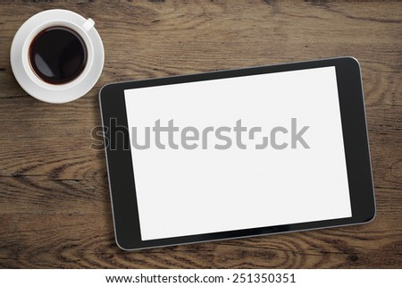 Black tablet ipad on table desk with coffee cup  - stock photo