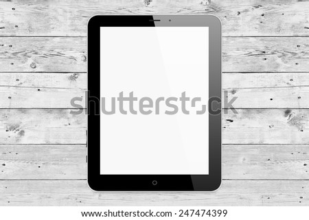 Black tablet pc same with ipade on wood background - stock photo