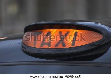 Black Taxi Cab Sign - stock photo