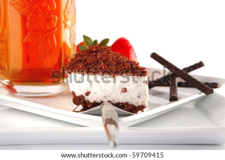 black tea and cake served with strawberry - stock photo