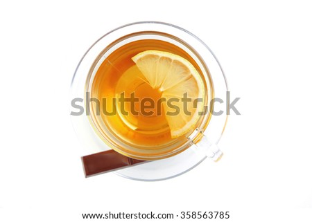 black tea and chocolate bar on white - stock photo
