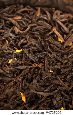 black Tea background, texture dry leaves, tea scented with bergamot oil Macro background - stock photo