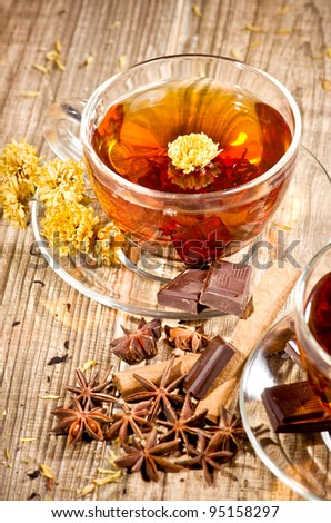 Black tea, cinnamon and dry flowers - stock photo