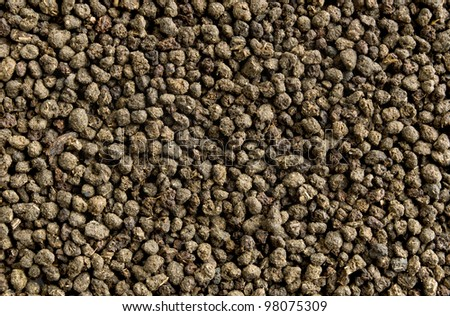Black tea granulated background