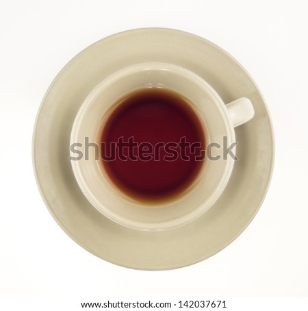 Black tea in cup isolated on white overhead shot - stock photo