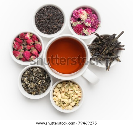 Black Tea in White Cup with tea leaves and flowers.