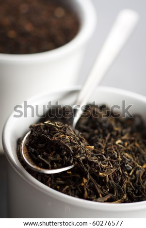 Black tea leaves in the cup,shallow focus - stock photo